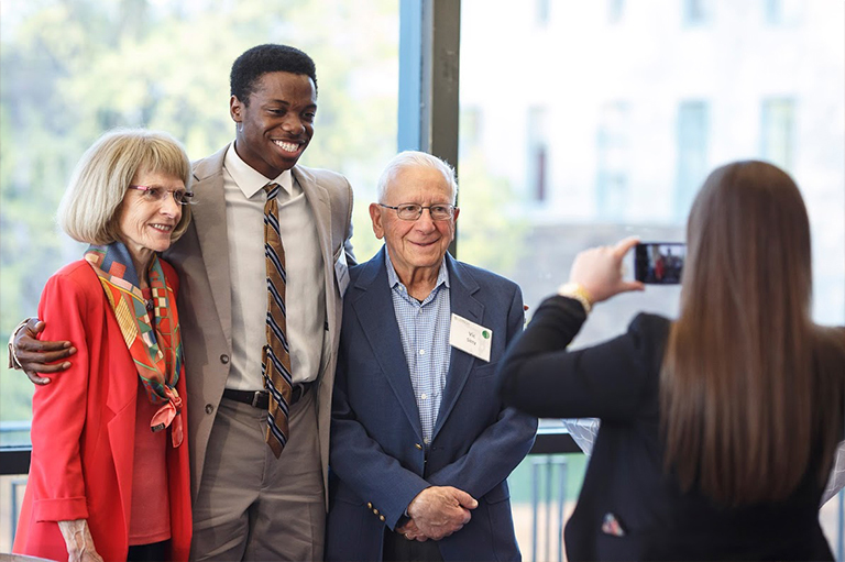 Penny Miller with Daniel Amankwatia '19 and her husband, Victor Sitty