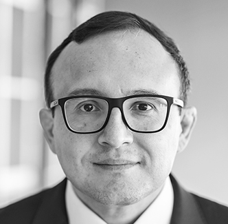 black and white photo of Eduardo Gómez