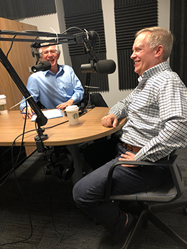 William Crow and John Simon laughing together in studio during the podcast recording